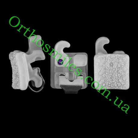Керамічні самолігуючі брекети фото 1 — OrthoSmiles