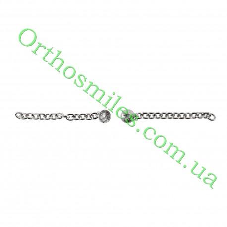 Лінгвальна кнопка металева з ланцюжком фото 1 — OrthoSmiles