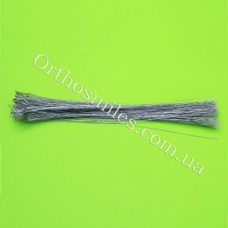 Лигатура металлическая длинная 100 шт фото 1 — OrthoSmiles