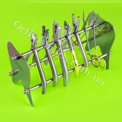 Подставка под инструмент в форме зуба