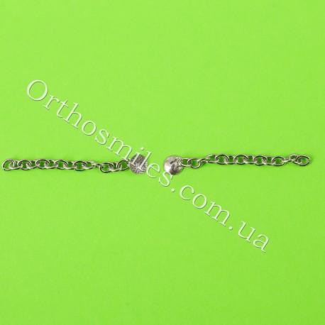 Лингвальная кнопка металлическая с цепочкой фото 1 — OrthoSmiles