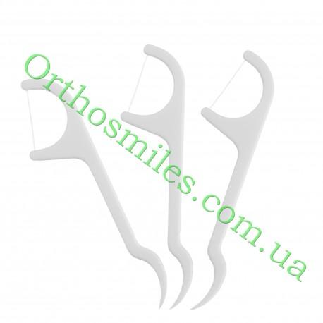 Зубная нить с держателем зубочисткой фото 1 — OrthoSmiles